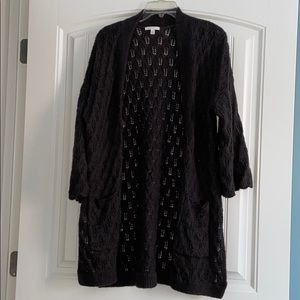 Long sweater with pockets and side slits